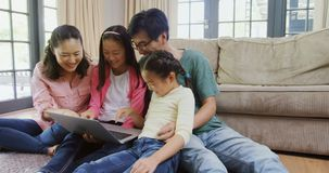 Family using laptop together in living room 4k. Happy Family using laptop together in living room at home 4k stock video