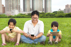 Happy family using smart phone Stock Photos