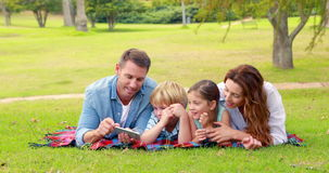 Happy family using tablet computer stock footage