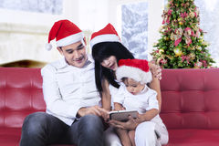 Happy family using tablet computer Stock Image