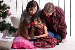 Happy family using the tablet. Stock Photography