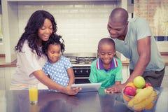 Happy family using tablet Royalty Free Stock Photos