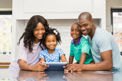 Happy family using tablet Stock Image