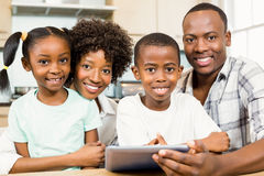 Happy family using tablet in kitchen Royalty Free Stock Photo