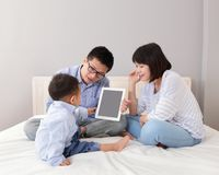 Happy family using tablet pc Stock Photo