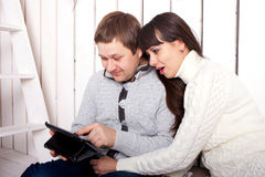 Happy family using a tablet PC. Stock Photography