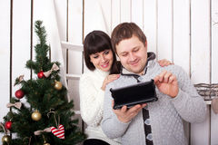Happy family using a tablet PC Royalty Free Stock Photo