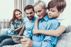 Happy Family Using Tablet PC Together at Home. Using Digital Device. Spending Time Together at Home. Father and Son. Smiling People. Have Fun Indoor royalty free stock image