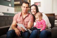 Happy family using technology at home Royalty Free Stock Photography