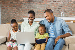 Happy family using technology together Stock Image