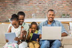 Happy family using technology together Royalty Free Stock Photography