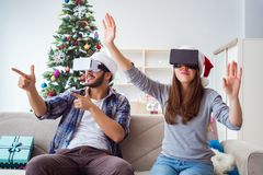 The happy family using virtual reality vr glasses during christmas Stock Photography