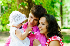Happy family on vacation. A young family on holiday in the park Stock Photo