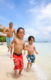Happy family on vacation Stock Photos
