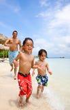 Happy family on vacation Stock Photos
