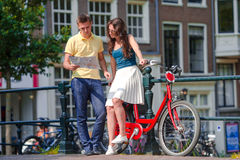 Happy family vacation on bikes in old streets in Amsterdam Stock Photography