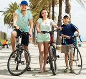 Happy family on vacation riding bicycles Stock Image