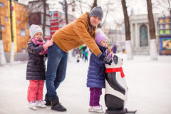 Happy family vacation on skating rink Stock Photography