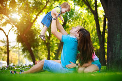 Happy family on vacation in the summer park Royalty Free Stock Images