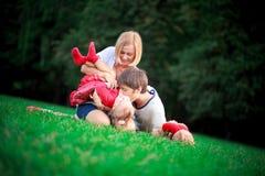 Happy family on vacations Stock Photos