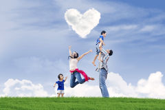 Happy family Valentine's day. Happy family enjoying Valentine's day in the park Royalty Free Stock Photos