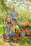 Happy  family with vegetables harvest. In garden Royalty Free Stock Photo