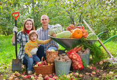Happy  family with vegetables harvest Royalty Free Stock Image