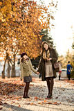 Happy family. Vertical photo,  happy beautiful little girl with mather  walking in park Royalty Free Stock Photography