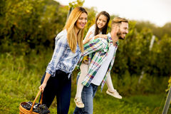 Happy family in vineyard at sunny day Stock Images