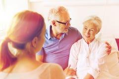 Happy family visiting senior woman at hospital Royalty Free Stock Image