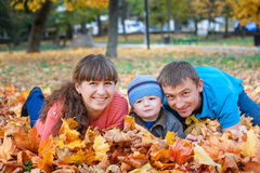 Happy family on walk in autumn park Stock Photography