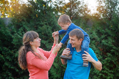 Happy family on walk in autumn park Royalty Free Stock Photos