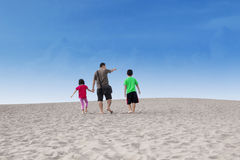 Happy family walk on desert Stock Photo