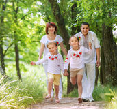 Happy family on the walk in park Royalty Free Stock Image