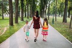 Happy family walk park nature concept. Delights of motherhood Royalty Free Stock Photos