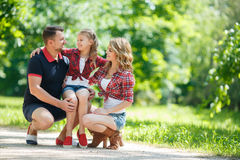 Happy family on a walk in  Park in the summer. Royalty Free Stock Images