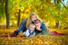 Happy family walking at the autumn nature Stock Photo