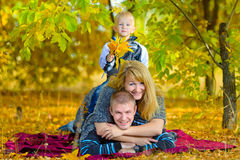 Happy family walking at the autumn nature Royalty Free Stock Image