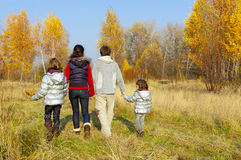 Happy family walking in autumn park Stock Image