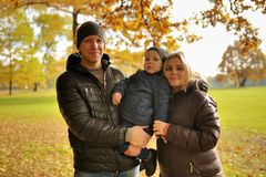 Happy family walking in autumn park Stock Photography