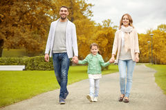 Happy family walking in autumn park Royalty Free Stock Image