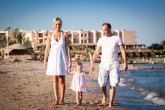Happy family walking at the beach Stock Photography
