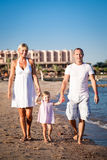 Happy family walking at the beach Stock Images