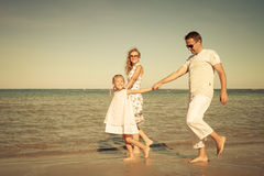 Happy family walking at the beach. At the day time Stock Image