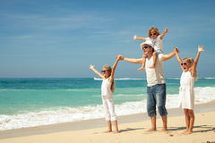 Happy  family  walking on the beach at the day time. Stock Image