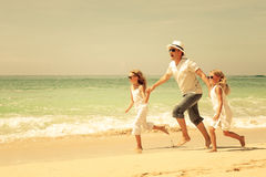 Happy  family  walking on the beach at the day time. Stock Photography