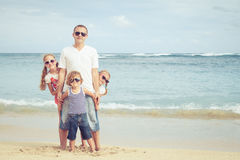 Happy family walking on the beach at the day time. Royalty Free Stock Images