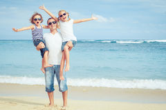 Happy family walking on the beach at the day time. Royalty Free Stock Photos