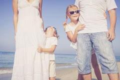 Happy family walking on the beach at the day time. Royalty Free Stock Photography