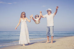 Happy family walking on the beach at the day time. Stock Images